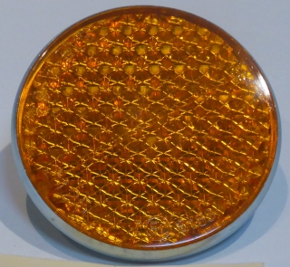 Reflector, amber, Norton coil housing 2-1/4 in